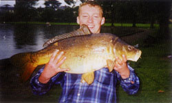 Ross Macklin with a 17 lb 4 oz carp from the Lough in Cork, August 2001